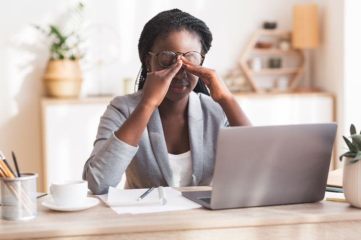 Eye Strain. Overworked Black Businesswoman Massaging Nosebridge At Workplace Having Eyesight Problem, Selective Focus, Does Stress Make Chronic Pain Worse?