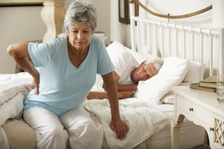 Senior Woman Suffering From Backache Getting Out Of Bed, wondering why is my nerve pain worse at night.