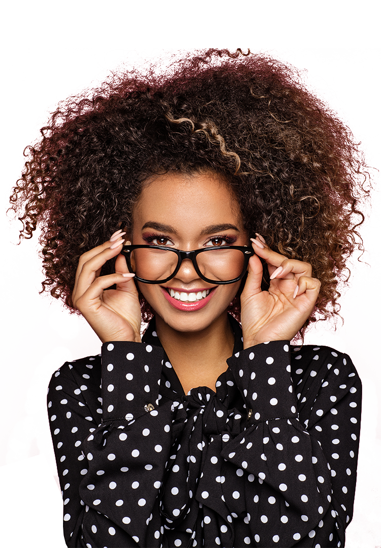 African American professional holding her glasses confidently and smiling.