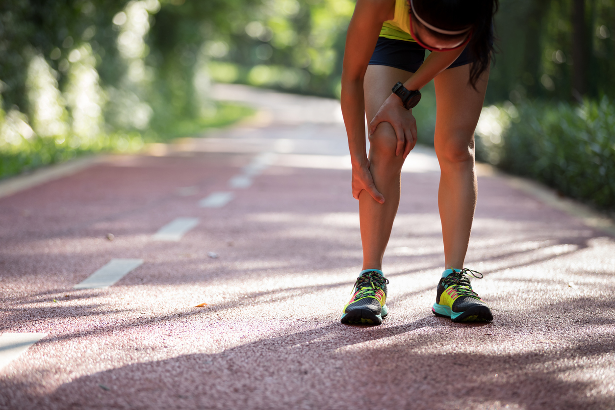 Female runner suffering with pain on sports running knee injury, wondering Will Exercise Help or Hurt Your Chronic Pain.